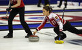 Curling women russia skip anna sidorova of delivers a stone at the ford world s championship march in saint john canada Royalty Free Stock Photography