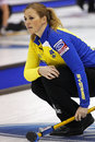 Curling women sweden bertrup christina s watches her shot at the ford world s championship march in saint john canada Royalty Free Stock Photo