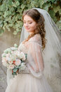 Curls cover shoulders of pretty bride Royalty Free Stock Photo