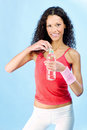 Curls hair woman and bottle of water smiled during exercise Stock Photo