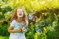 Curly girl with bubbles. Happy childhood concept. Royalty Free Stock Photo