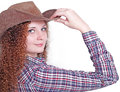 Curly girl in a cowboy hat Royalty Free Stock Image