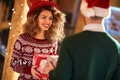 Curly girl exchanges gifts with boyfriends Royalty Free Stock Photo