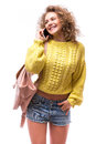 Curly girl talk to someone from smart phone Royalty Free Stock Photo