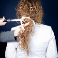 Curly hair and knife Stock Images