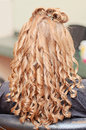Curly hair styling back view of woman with pin curled at a salon Stock Photo
