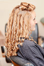 Curly hair styling side view of woman with pin curled at a salon Royalty Free Stock Photos