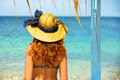 Curly haired woman looking at the sea Royalty Free Stock Photo