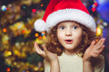 Curly little girl in santa hat beautiful Stock Photos