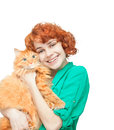 Curly red haired girl with a red cat isolated on white Royalty Free Stock Photo