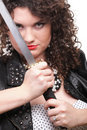 Curly woman curly girl and sword dark hair natural brown haired holding in her hands a katana Royalty Free Stock Images