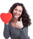 Curly woman holding heart and showing yes sign Stock Photos