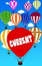 CURRENT written on hot air balloon with a blue sky background. Royalty Free Stock Photo