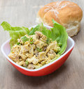 Curried chicken salad a savory on lettuce with bun in background Stock Image