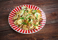 Curried hash brown scramble crispy browned potatoes tossed sauteed onions curry powder and scrambled eggs Stock Photos