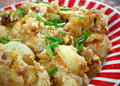 Curried hash brown scramble crispy browned potatoes tossed sauteed onions curry powder and scrambled eggs Stock Image