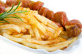 Curried sausage with chips isolated from backround Royalty Free Stock Images