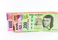 Currrency four mexican peso banknotes of various denominations over white Royalty Free Stock Photo