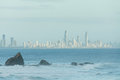 Currumbin rock with Gold Coast City as background Royalty Free Stock Photo