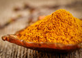 Curry powder in small vintage container Royalty Free Stock Photography