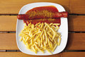Curry sausage with chips in plate Royalty Free Stock Photo