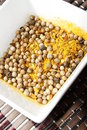Curry spice blend in white bowl close up Royalty Free Stock Photography
