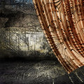 Curtain and grunge wall background Royalty Free Stock Photo