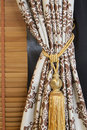 A curtain hold back by tassel Stock Images