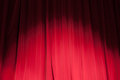 Curtain from the theatre with a spotlight as background Stock Photo