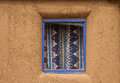 Curtained window in an adobe wall Stock Photography