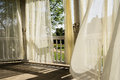 Curtains fluttering in sunny autumn afternoon breeze Royalty Free Stock Photo