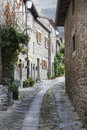 Curvature cozy narrow street in italy late afternoon Stock Photos
