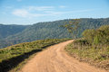 Curve dirt road in the mountain. Royalty Free Stock Photo