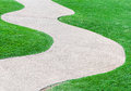 Curve pathway on the fresh grass of golf course Royalty Free Stock Image