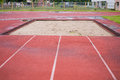 Curve of a red jump running track sand Royalty Free Stock Images
