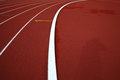 Curve on a red running track olympic Royalty Free Stock Photos