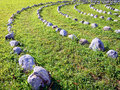 Curve of rocks at a meadow Royalty Free Stock Photography
