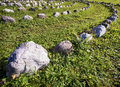 Curve of rocks at a meadow Royalty Free Stock Photo