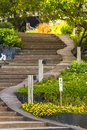 Curve stairway to garden. Royalty Free Stock Photo
