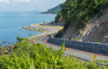 Curve street along the beach and mountain in thailand Royalty Free Stock Photography
