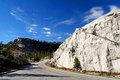 Curve uphill street at yosemite california against blue sky national park Royalty Free Stock Photo