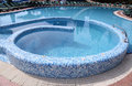 Curved blue tiled swimming pool Stock Photo
