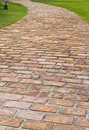 A curved brick path Stock Photos