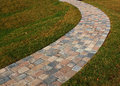 Curved brick path on grass home landscaping Royalty Free Stock Photos
