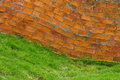Curved brick wall grass Royalty Free Stock Photo
