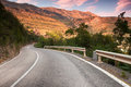 Curved mountain highway in soft early morning sun light Royalty Free Stock Photo