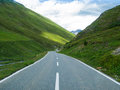 Curved narrow asphalt road in French Alps Stock Images