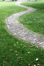 Curved path bent grass brick paved Royalty Free Stock Images
