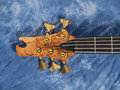 Curved patterned wood bass guitar headstock Royalty Free Stock Photo