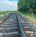 Curved railroad tracks single track railway in a rural setting Royalty Free Stock Images